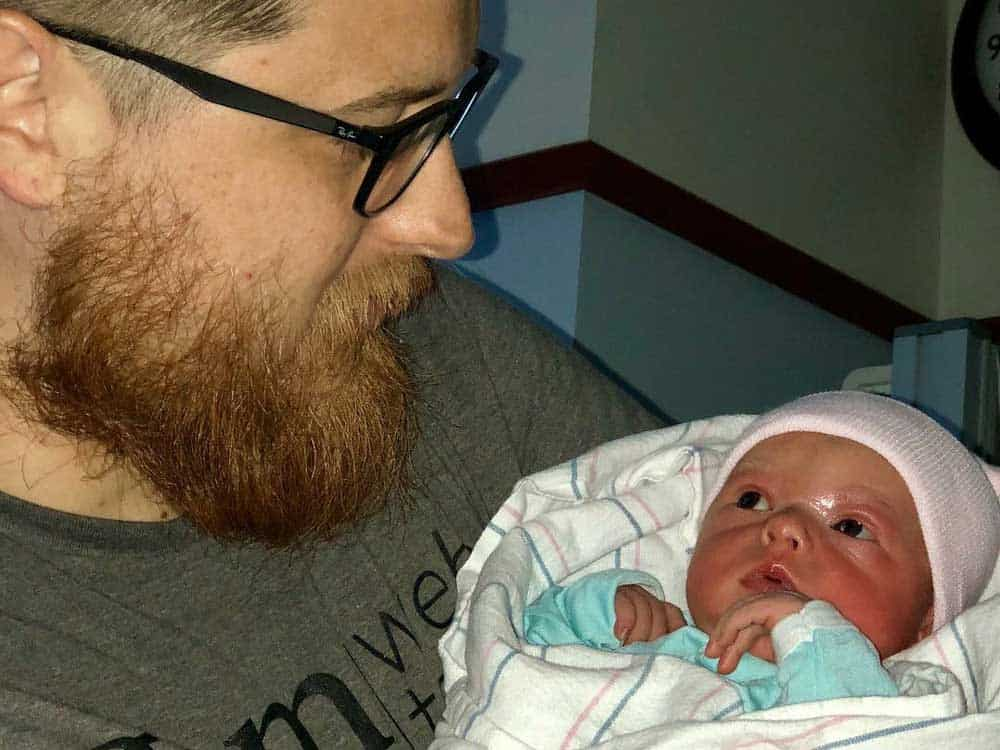 newborn baby looking at dad