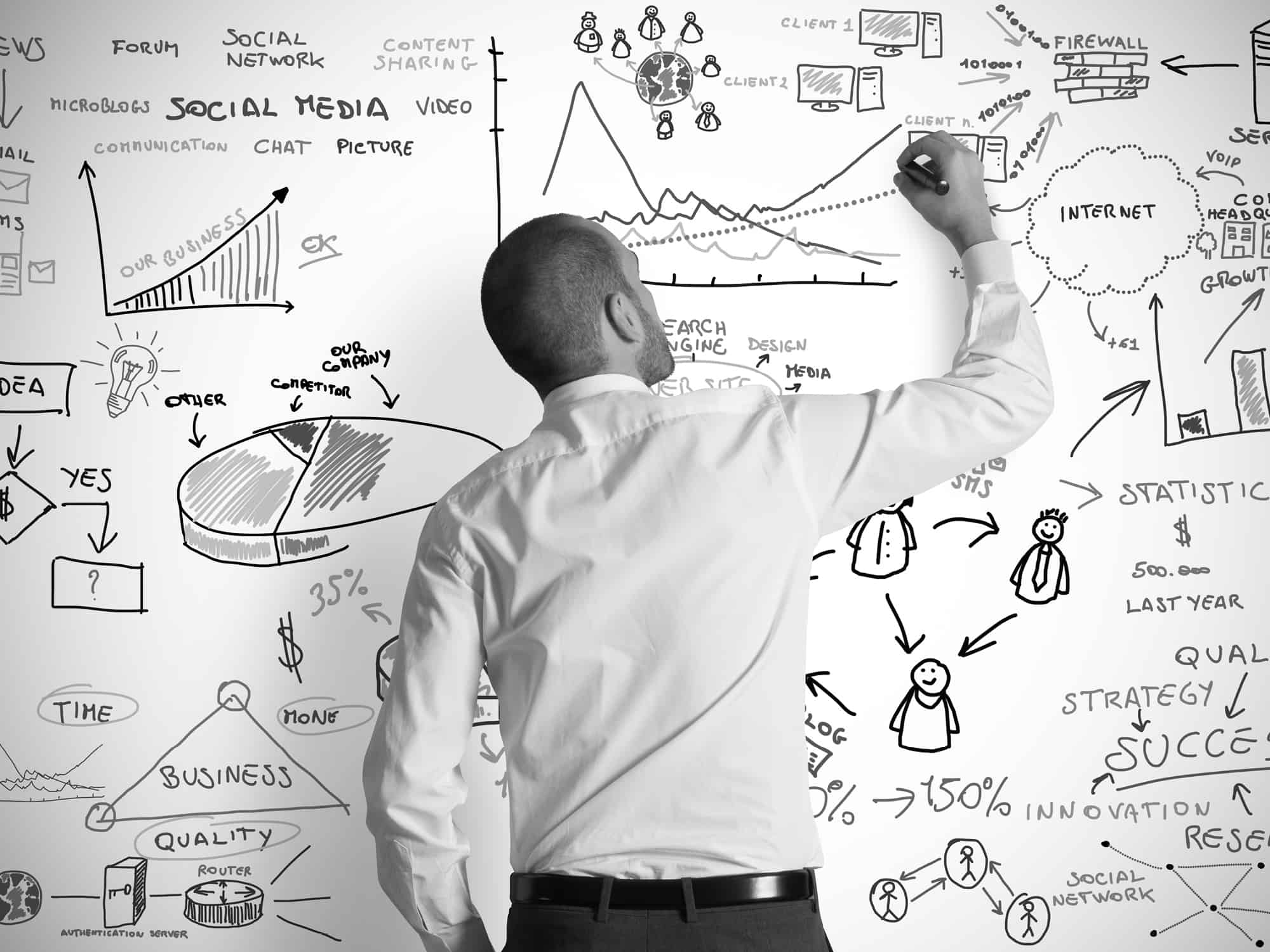 businessman on whiteboard black and white