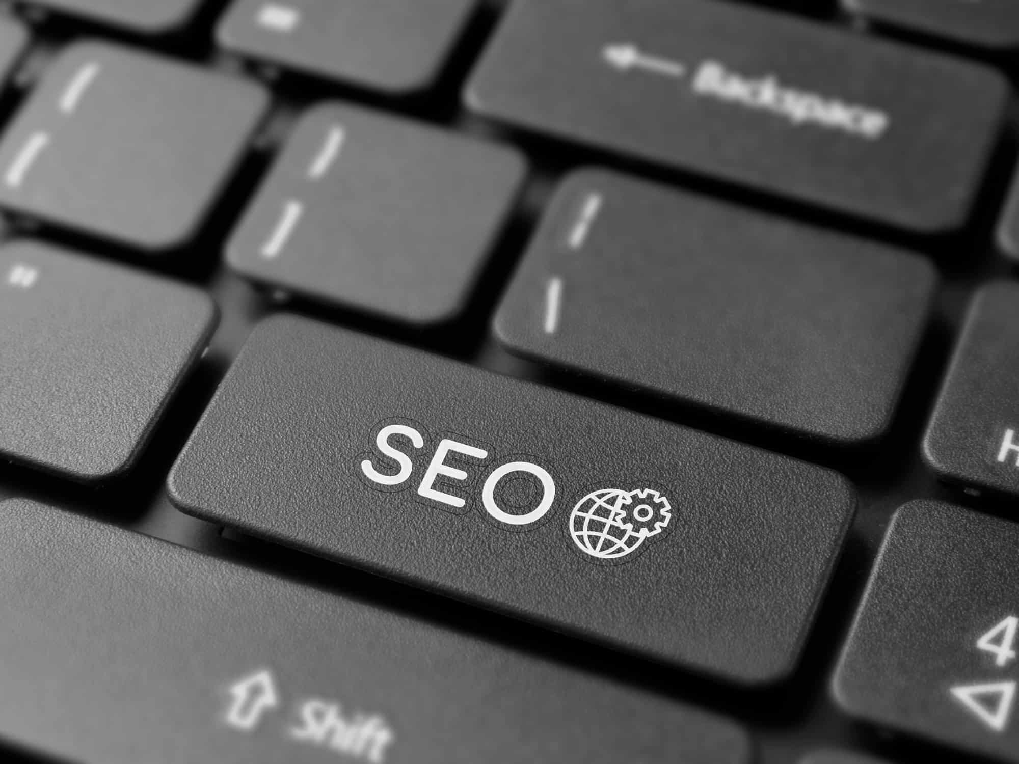 Dental SEO on keyboard black and white image