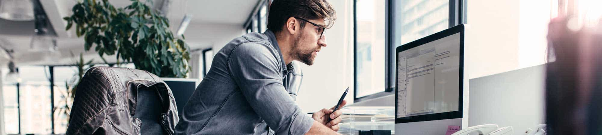 man looking at dental website