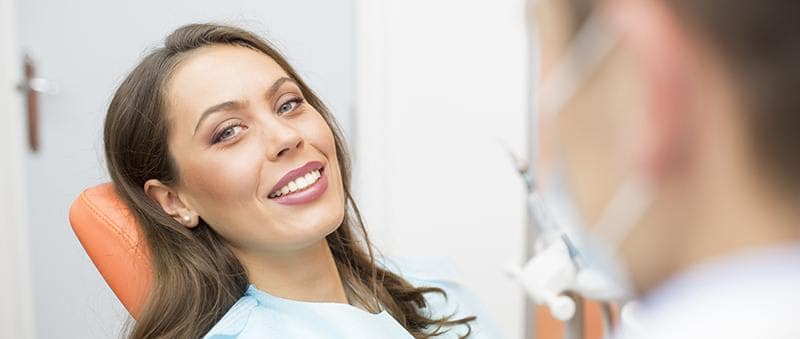female patient in dental chair