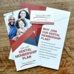 brochure for dental membership plan on table - Golden Proportions Marketing
